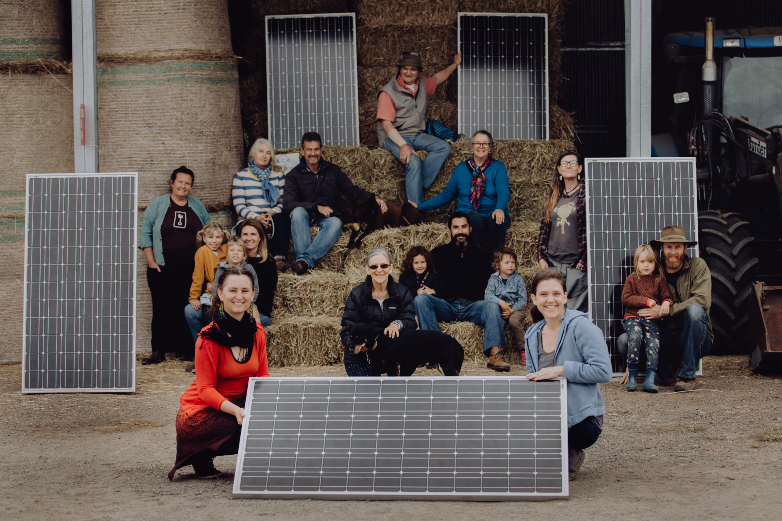 People with solar panels on haystacks